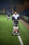 Tranmere Rovers 0 Stoke City 2, 25/09/2013. Prenton Park, Captial One Cup Third Round. The groundsmen mowing the pitch shortly after the final whistle at Prenton Park as Tranmere Rovers lose to Stoke City in a Capital One Cup third round match. The Capital One cup was formerly known as the League Cup and was competed for by all 92 English Premier League and Football League clubs. Visitors Stoke City won the match 2-0, watched by a crowd of 5,559 spectators. Photo by Colin McPherson.