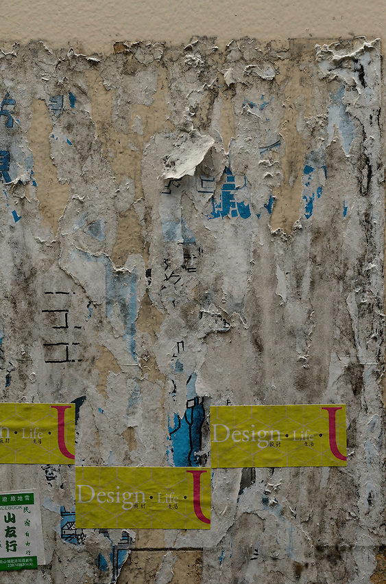 Layers of past poster campaigns.  Wan chai district, Hong Kong.
