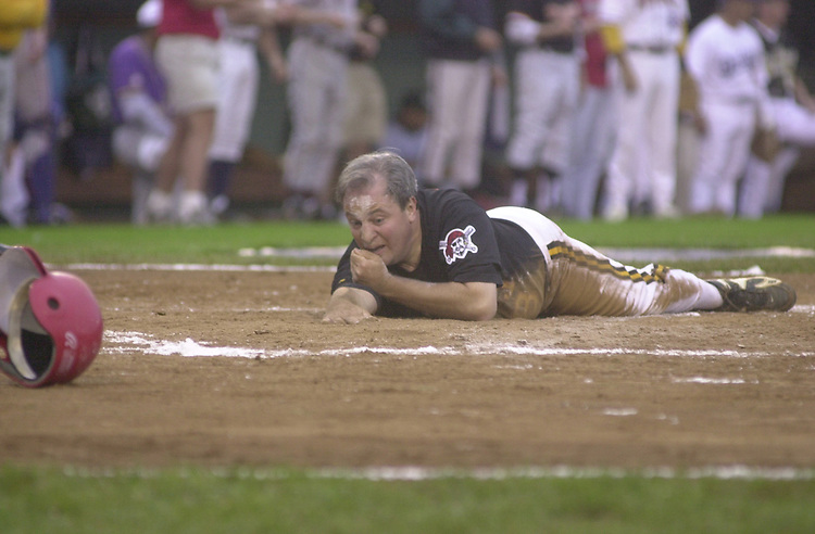 Baseball10(TW)072700-- Mike Doyle slides safe at home but injures his nose in the process.