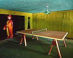One Armed Clown in a Game Room with a Ping Pong Table In the Abandoned Buck Hill Falls Inn in the Pocono's in Pennsylvania.