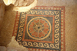 Israel, Masada, Mosaic floor in a ritual bath (Mikva)  Metzada is the site of ancient palaces and fortifications in Israel on top of an isolated rock cliff on the eastern edge of the Judean desert overlooking the Dead Sea. where Jewish zealot insurgents held out for three years against the Romans after the fall of Jerusalem in 70C.E. and then committed mass suicide to avoid capture. Metzada has remained a symbol of Jewish heroism.