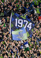 November, 2013: CenturyLink Field, Seattle, Washington:  Seattle Sounders FC fans wave a1974 banner as the Portland Timbers defeat  the Seattle Sounders FC 2-1 in the Major League Soccer Playoffs semifinals Round.