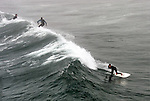 Surfers - Surfing Seal Beach, California.  Photograph by Alan Mahood.