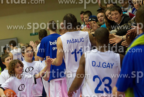 Drago Pasalic and Darnley Earl Gay of Helios with fans after the basketball match between KK Helios Domzale and Cibona Zagreb of 13th Round of ABA League, on December 23, 2011 in Dvorana Komunalnega centra, Domzale, Slovenia. (Photo By Vid Ponikvar / Sportida.com)