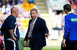 St Johnstone v Rangers... 30.07.11   SPL Week 2.Ally McCoist has words with the fourth official Kevin Clancy.Picture by Graeme Hart..Copyright Perthshire Picture Agency.Tel: 01738 623350  Mobile: 07990 594431