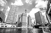 Photo of Chicago downtown river buildings along the Chicago river at Michigan Avenue Bridge (DuSable Bridge) inlcuding the Wrigley Building, Tribune Tower, and The Equitable Building.