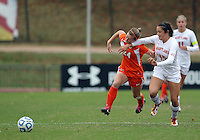 COLLEGE PARK, MD - OCTOBER 28, 2012:  Erika Nelson (15) of the University of Maryland holds off Tara Schwitter (24) of Miami during an ACC  women's tournament 1st. round match at Ludwig Field in College Park, MD. on October 28. Maryland won 2-1 on a golden goal in extra time.