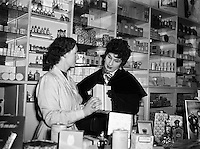 Mr Eamon Andrews and Alma Cogan at Woulfes Pharmacy, Grafton St.01/12/1954..Alma Cogan (19/05/1932 - 26/10/1966) was an English singer of traditional pop music in the 1950s and early 1960s. Dubbed &quot;The Girl With the Laugh/Giggle/Chuckle In Her Voice&quot;, she was the highest paid British female entertainer of her era. Throughout the mid-1950s, she was the most consistently successful female singer in the UK.