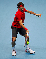 Roger Federer (SUI) (1) against Robin Soderling (SWE) (4) in their Group B  match. Roger Federer beat Robin Soderling 7-6 6-3..International Tennis - Barclays ATP World Tour Finals - O2 Arena - London - Day 5 - Thu 25 Nov 2010..© Frey - AMN Images, Level 1, Barry House, 20-22 Worple Road, London, SW19 4DH.Tel - +44 208 947 0100.Email - Mfrey@advantagemedianet.com.Web - www.amnimages.photshelter.com