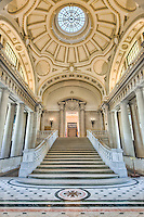 """The stairs leading to Memorial Hall inside Bancroft Hall, the largest dormitory in the world, located at the US Naval Academy in Annapolis, Maryland.  A replica of the historic battle flag with the words """"Don't Give Up the Ship"""" is on display in Memorial Hall and can be seen through the doorway at the top of stairs."""