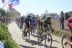 The peloton including Sylvain Chavanel (FRA) Direct Energie on pave sector 29  Troisvilles a Inchy during the 115th edition of the Paris-Roubaix 2017 race running 257km Compiegne to Roubaix, France. 9th April 2017.<br /> Picture: Eoin Clarke | Cyclefile<br /> <br /> <br /> All photos usage must carry mandatory copyright credit (&copy; Cyclefile | Eoin Clarke)