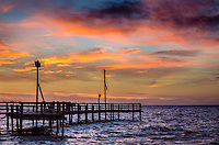 Dramatic sunset at cedar point fishing pier in alabama for Dauphin island fishing pier