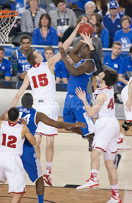 Kentucky Wildcats forward Julius Randle (30) throws the ball towards the basket while Wisconsin Badgers forward Sam Dekker (15) and forward Frank Kaminsky (44) during the NCAA Final Four vs. Wisconsin at the AT&T in Arlington, Tx., on Saturday, April 5, 2014. Photo by Eleanor Hasken | Staff