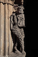 Armed man, wearing chain mail, 15th century, statue on the left side of the main door and entrance, Cathedral of San Salvador, 12th-14th century, Avila, Castile and Leon, Spain. Avila Cathedral is a strong, fortress-like cathedral adjoining the famous medieval city walls. Photograph by Manuel Cohen