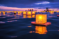 Each floating lantern has writing on it honoring deceased loved ones at the Annual Lantern Floating Ceremony, Ala Moana Beach Park, O'ahu.