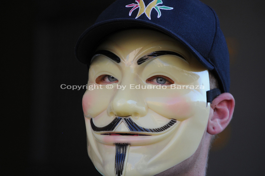 Phoenix, Arizona. September 17, 2012 - A small crowd of demonstrators in Phoenix, Arizona gathered to mark one year since the beginning of the Occupy Movement that opposes Wall Street and large corporations that represent the one percent who control wealth in the United States. In this photograph, a man wearing an 'Anonymous' mask stands outside the Fourth Avenue Maricopa County Jail to protest Sheriff Joe Arpaio. The man was part of the Occupy Phoenix group that organized the march and protest. Photo by Eduardo Barraza © 2012