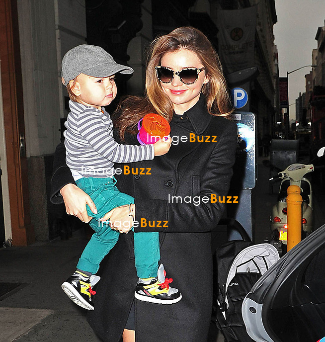 Miranda Kerr strolls her son Flynn out of their apartment  in New York City..The 29-year-old model and her little guy headed to Midtown Manhattan to an office building..New York, December 7, 2012.