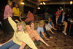 "Rowing Boat Dance, danced to 'Oops Upside Your Head' otherwise known as ""I Don't Believe You Want To Get Up And Dance (Oops!)"" by the Gap Band. Also known as the Row Boat song. This song was danced to by sitting on the floor and performing a rowing and wave movement. Duke of Cambridge, South London pub Hen Night.1985"