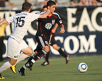 Pablo Hernandez #21 of D.C. United gets away from JT Noone #15 of the Harrisburg City Islanders during a US Open Cup match at the Maryland Soccerplex on July 21 2010, in Boyds, Maryland. United won 2-0.