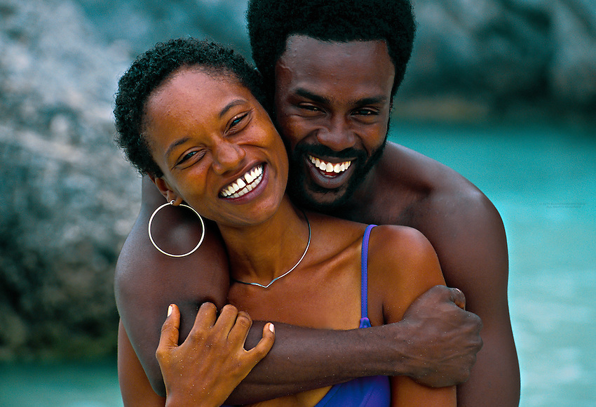 Bermudian couple at the beach, Horseshoe Bay, Bermuda; Smiling; Happy; Swimsuit; Beach; Man; Black Man; Woman; Black Woman; People
