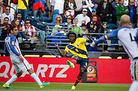 Seattle, WA - Thursday, June 16, 2016: Ecuador defender Juan Carlos Paredes (4) crosses the ball during a Quarterfinal match of the 2016 Copa America Centenrio at CenturyLink Field.