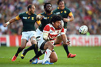 Keita Inagaki of Japan passes the ball. Rugby World Cup Pool B match between South Africa and Japan on September 19, 2015 at the Brighton Community Stadium in Brighton, England. Photo by: Patrick Khachfe / Onside Images