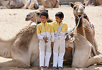 Camel racing boy jockeys at Al Ain in Abu Dhabi, United Arab Emirates, Middle East