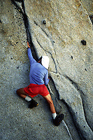Climber on rock face, Prusik Peak, Washington