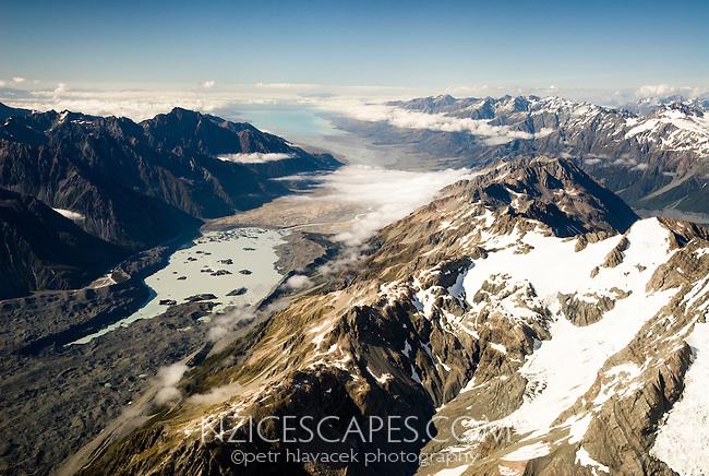 Aerial views of lower part of Tasman Glacier and its terminal lake. Lake Pukaki in far distance on horizon, Aoraki Mt. Cook National Park, Mackenzie Country, World Heritage Area, New Zealand