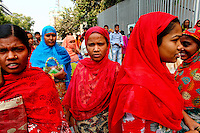 Workers make their way to work to their textile factories early in the morning.