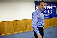 Republican presidential hopeful Tim Pawlenty arrives at a campaign stop on Thursday, July 21, 2011 in Webster City, IA.