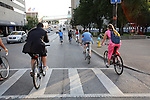 Bike Prom participants take up a lane on South Broadway as they trek to their next checkpoint Saturday evening. Photo by Adam Wolffbrandt | Staff.