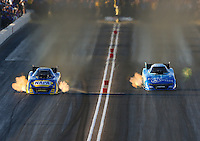 Feb 27, 2016; Chandler, AZ, USA; NHRA funny car driver Ron Capps (left) races alongside Tommy Johnson Jr during qualifying for the Carquest Nationals at Wild Horse Pass Motorsports Park. Mandatory Credit: Mark J. Rebilas-USA TODAY Sports