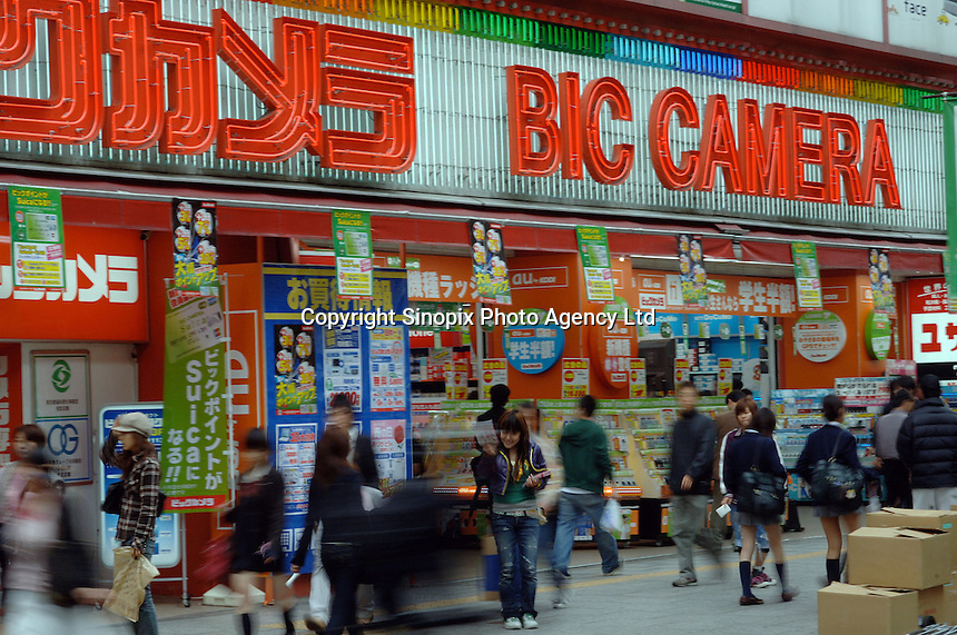 Shoppers walk by Bic Camera in Tachikawa, Tokyo. Bic Camera is one of Japan's leading retailers of electronic consumer items, cameras and watches..