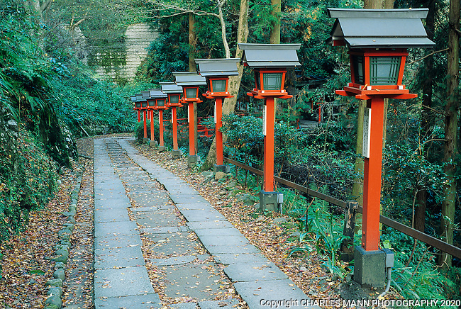 A line of orange lanterns on the pathway leading up the slopes of Mount Kurama  gives a sense of the mystical nature of the  big mountain, located north a few miles north of Kyoto.