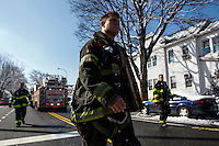 NYFD members arrive to the house where at least 7 children died during the fire in Brooklyn, New York. 21.03.2015. Gary Hershorn/VIEWpress.