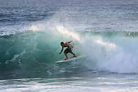 Surfing and Body boarding high surf on the south shore of Hawaii's oldest island Kauai.
