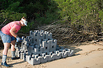 TNC Marine Restoration Specialist Joy moves Oyster Castle Blocks to Shoreline where Oyster Castles are being constructed,