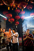 Devout Chinese offer their prayers at the Goddess of Mercy temple in capital Georgetown of Penang, Malaysia. The Goddess of Mercy Temple or Kuan Yin Ting is the oldest Chinese temple in Penang, built in 1880s by early immigrants from China. Photo: Sanjit Das/Panos