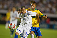 Miami, FL - Saturday, Nov 16, 2013: Brazil vs Honduras during an international friendly at Miami's Sun Life Stadium. Brazilian Neymar (10) and Arnold Peralta (12) dispute the ball.
