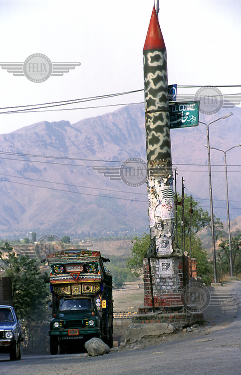 ©Piers Benatar/Panos Pictures..North West Frontier Province, Pakistan. 2001...Pakistan is very proud of its status as the only Muslim nuclear power, a pride which manifests itself in sculptures, murals and merchandising paraphernalia depicting its Ghauri and Shaheen missiles.