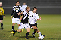Vince Savarese (6) of the UMBC Retrievers and Manny Sardinha (14) of the Princeton Tigers. UMBC Retrievers defeated Princeton Tigers 2-1 during the first round of the 2010 NCAA Division 1 Men's Soccer Championship at Roberts Stadium in Princeton, NJ, on November 18, 2010.