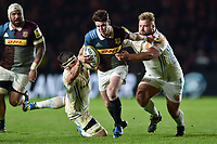 Tim Swiel of Harlequins gets past Don Armand and Tomas Francis of Exeter Chiefs. Aviva Premiership match, between Harlequins and Exeter Chiefs on April 14, 2017 at the Twickenham Stoop in London, England. Photo by: Patrick Khachfe / JMP