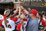 RALEIGH, NC - MARCH 29: NC State players and coaches huddle before the game. The North Carolina State University Wolfpack hosted the Liberty University Flames on March 29, 2017, at Dail Softball Stadium in Raleigh, NC in a Division I College Softball game. Liberty won the game 5-3.