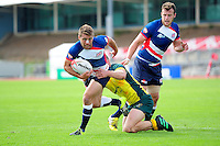 Samuel Pointon of Great Britain is tackled. FISU World University Championship Rugby Sevens Men's Cup Final between Australia and Great Britain on July 9, 2016 at the Swansea University International Sports Village in Swansea, Wales. Photo by: Patrick Khachfe / Onside Images