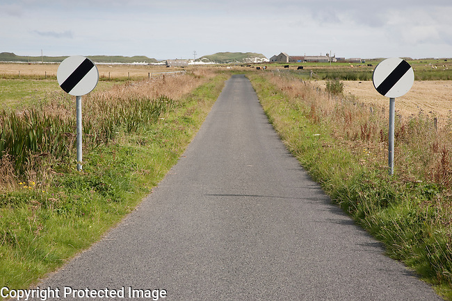 Empty Rural Road with Two Traffic Signs