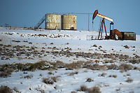 "An oil well pump jack runs on the plains near Douglas, Wyo., Thursday, November 22, 2013. The state will require pre-drilling testing of groundwater at sites where hydraulic fracturing, also known as ""fracking"" is used. (Kevin Moloney for the New York Times)"
