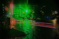 Nederland, Zeist, 22 okt 2014<br /> Wijk Kerckebosch in Zeist. Flats worden binnenkort afgebroken. Voor de veiligheid van de nog aanwezige bewoners en om vandalisme tegen te gaan is er camerabewaking opgesteld. Een felle groene lamp moet inbrekers op afstand houden. Foto is gemaakt op een regenachtige avond met mooie reflecties in de gevel door regeldruppels op het raam.<br /> Foto: (c) Michiel Wijnbergh