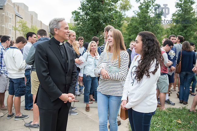 Aug. 25, 2015; University President Rev. John Jenkins, C.S.C., chats with students at the Opening Picnic on North Quad. (Photo by Barbara Johnston/University of Notre Dame)