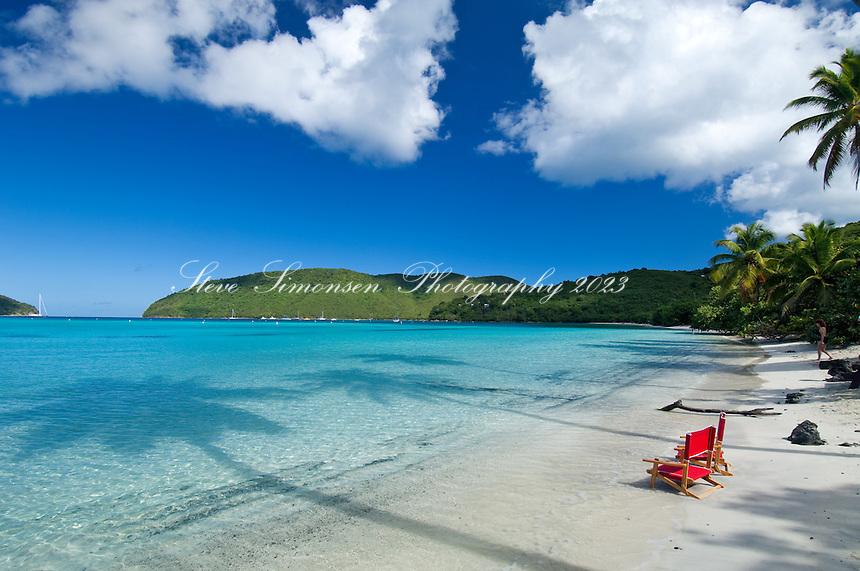 Red beach chairs <br /> Big Maho Bay beach<br /> Virgin Islands National Park<br /> St. John, U.S. Virgin Islands